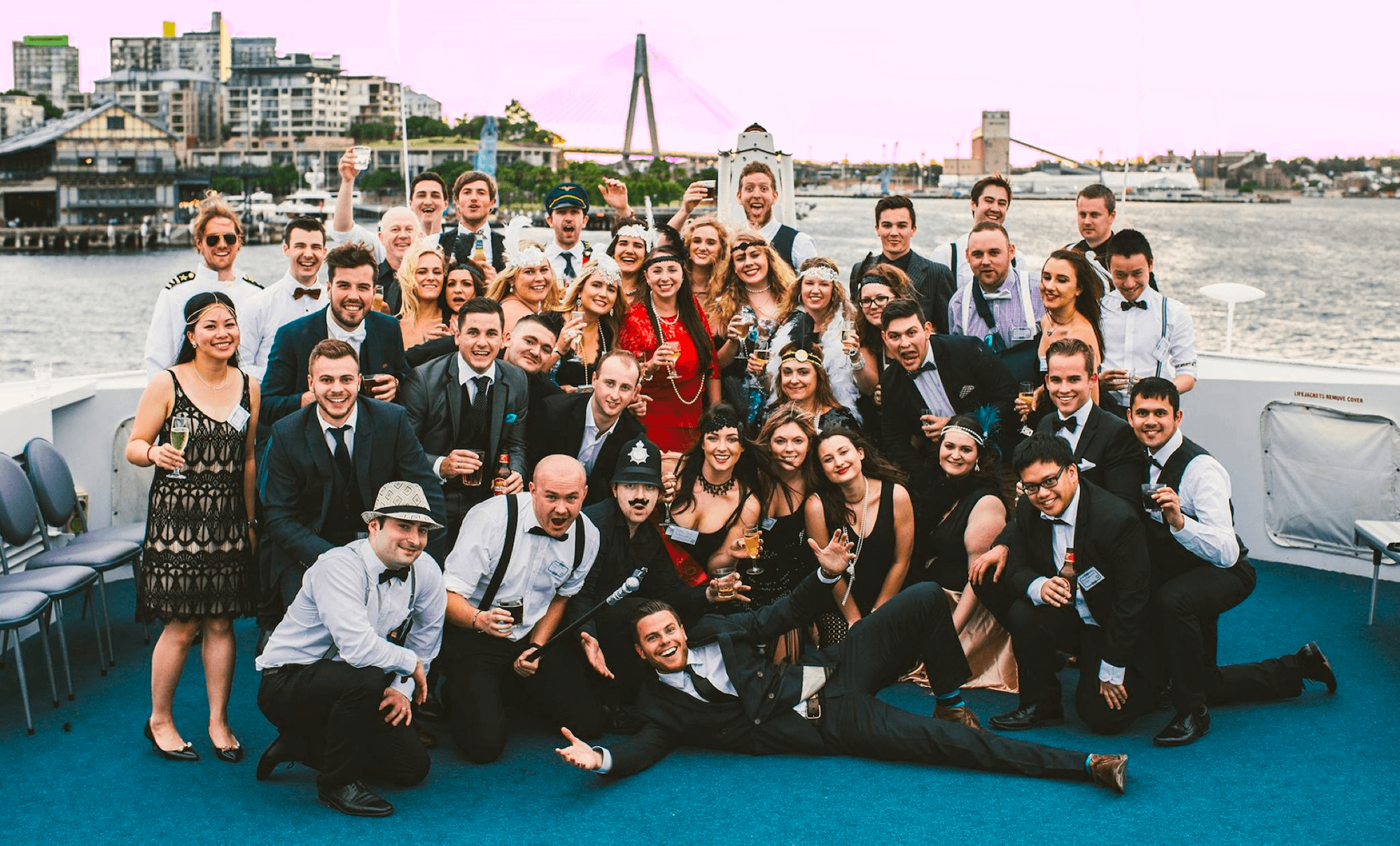 Group of people in dress up on a boat